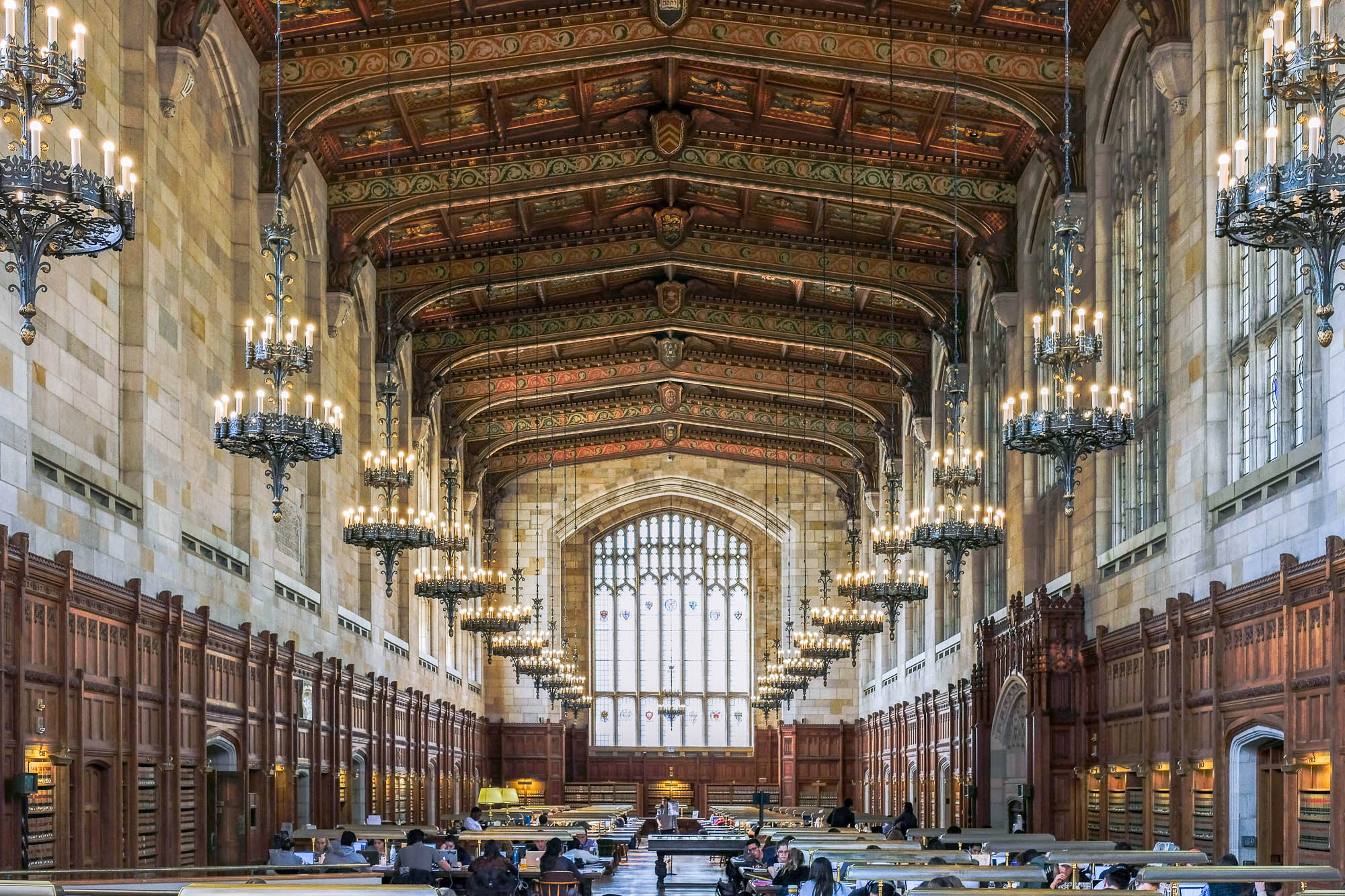 Image of the Cook Library, a neogothic reading room with a decorated ceiling and chandeliers.